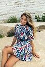 Rochie Delia alba cu imprimeuri diverse bleumarin si volanase pe fusta